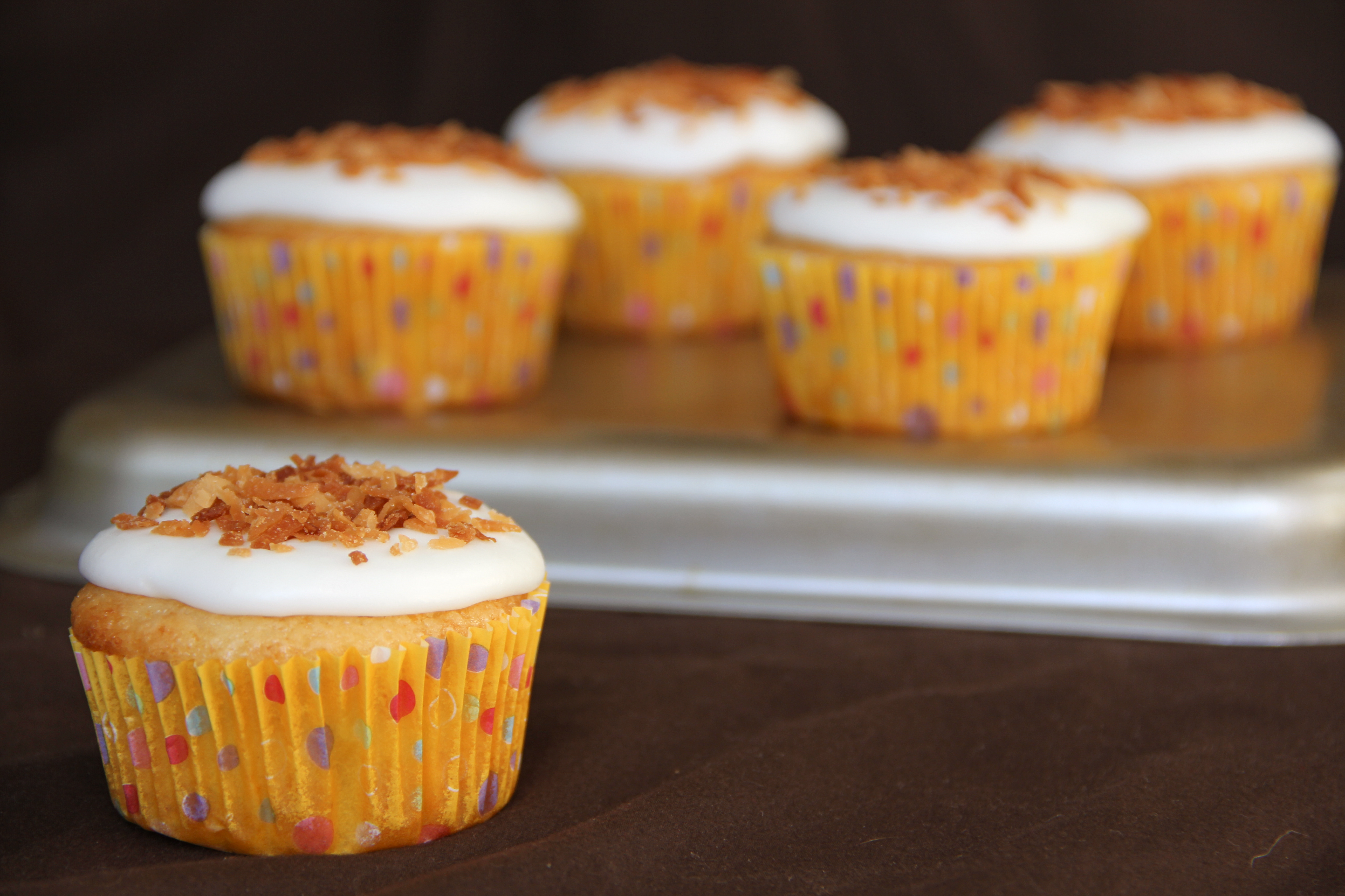 lemon cupcakes with coconut frosting and chocolate filling